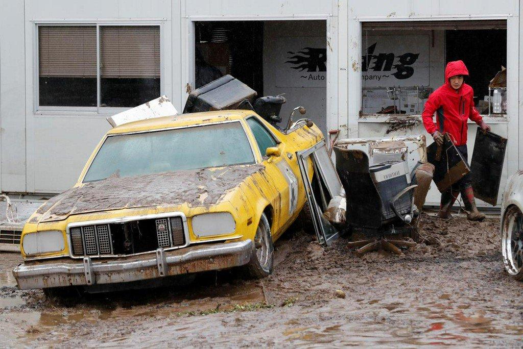 Rescue workers battle mudslips, waist-high waters in typhoon-hit Japan
