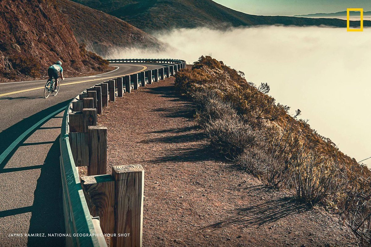 A cyclist cruises down a scenic California highway in this image captured by Your Shot photographer Jayms Ramirez. <br>http://pic.twitter.com/zw8kTcFB4Z