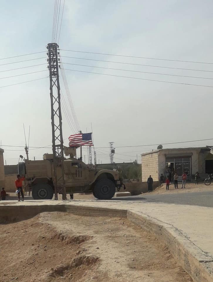 A US military convoy with helicopters over, crosses from al-Mahmudli town heading to north on #AinalArab - #Manbij road. #Syria #US #Turkish #SDF