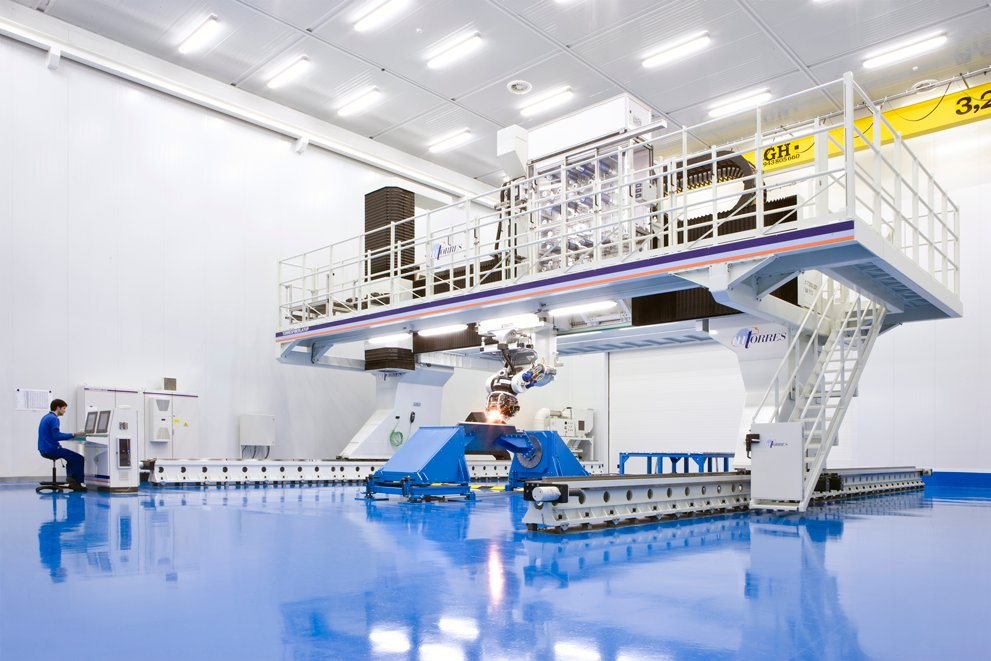 A large pool designed for experiments. Over it is a large white platform.