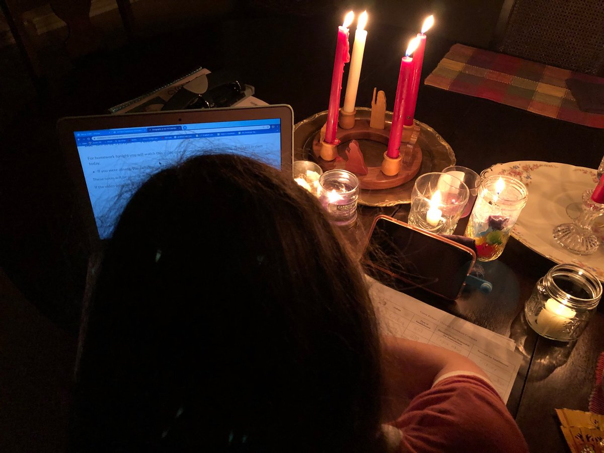 After tonight's thunderstorm, it's homework by candlelight...and computer batteries. #poweroutage #parenting