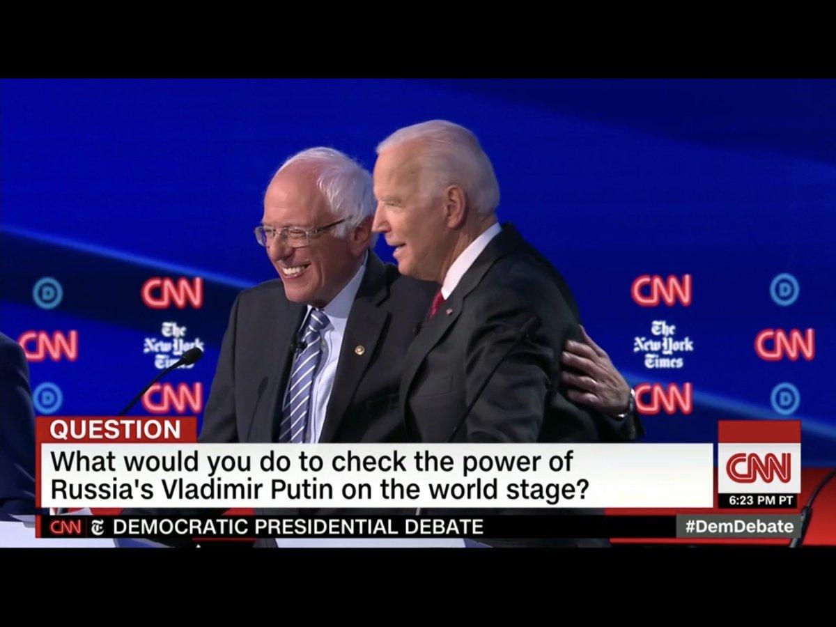 Who says Bernie never smiles? Hug it out. #DebateWithBernie #DemDebate