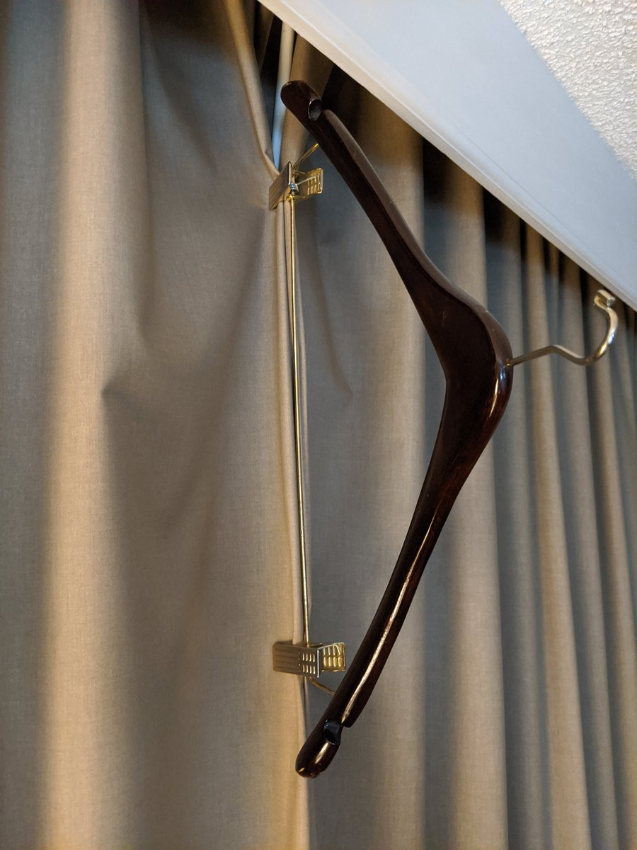 This Hotel Hanger Hack Is Genius For Keeping the Room Dark For Sleep