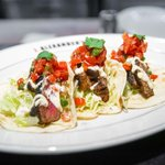 Image for the Tweet beginning: Happy #NationalTacoDay! Our Steak Tacos