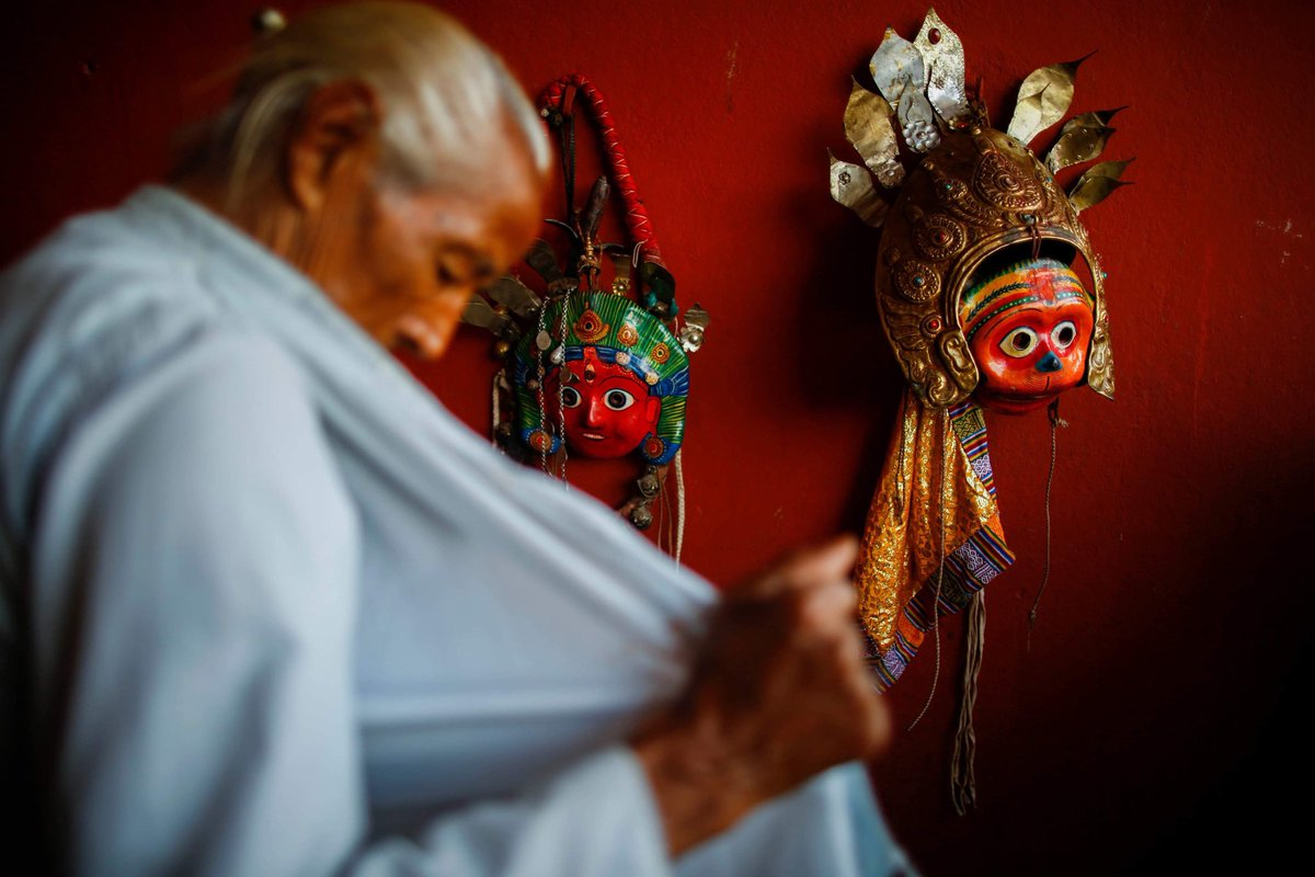 A man in trance donned as a deity performs a religious dance during Shikali festival an alternative to Dashain festival that dates back to more than 300 years observed by the people from the ethnic Newar community in Lalitpur, Nepal on Friday, October 4, 2019.