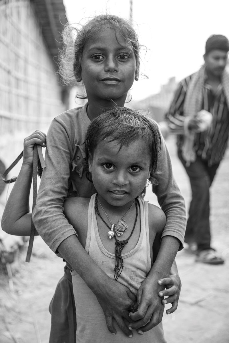 Two children posing for the camera. They are fascinated by a DSLR camera and are enjoying this novel experience. Photo @digitalsubway @preeti_akarna Read more on our website. #Nepal #Madhes
