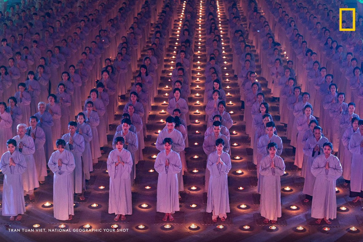 """""""Hundreds of Buddhists pray in the night of flower garlands and colored lanterns in Quan Am Bodhisattva Buddha Day, a respectful ritual to pray for peace and health of mankind at the Dien Quang Pagoda,"""" writes #YourShotPhotographer Tran Tuan Viet. https://on.natgeo.com/2Vj0Aen"""