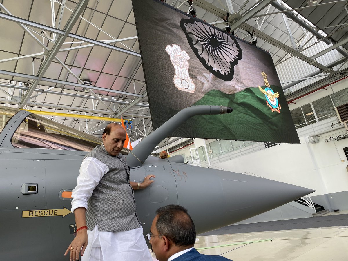 Rajnath Singh flies in Rafale fighter jet, takes delivery for IAF