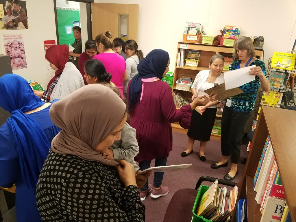 PACT time fun. Moms checking out books and ice cream name activity.  <a target='_blank' href='http://twitter.com/APSface'>@APSface</a> <a target='_blank' href='http://twitter.com/APS_EarlyChild'>@APS_EarlyChild</a> <a target='_blank' href='http://twitter.com/APSTitleI'>@APSTitleI</a> <a target='_blank' href='http://twitter.com/JohnsonCintia'>@JohnsonCintia</a> <a target='_blank' href='http://search.twitter.com/search?q=familyliteracy'><a target='_blank' href='https://twitter.com/hashtag/familyliteracy?src=hash'>#familyliteracy</a></a>. <a target='_blank' href='http://twitter.com/NCFL'>@NCFL</a> <a target='_blank' href='https://t.co/rLt7XKUXiD'>https://t.co/rLt7XKUXiD</a>