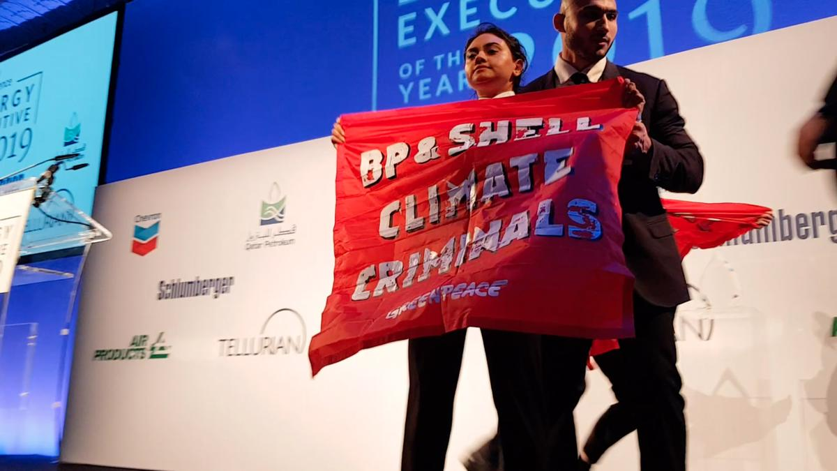 BREAKING: Greenpeace activists just crashed the stage at a major oil industry gala as @BP_plc's CEO was due to hand an award to @Shells CEO #OM2019 BP&Shell are knowingly plunging us deeper into the #ClimateEmergency. They're climate criminals & everyone needs to hear it. RT!