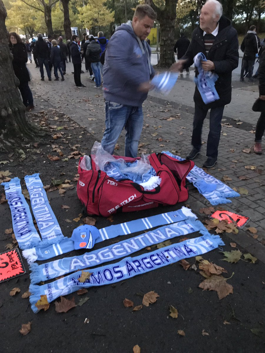 """Bloke outside the stadium in Dortmund selling Argentina scarves and hats — """"everything €2 a piece"""" — trading surprisingly well... #GERARG"""