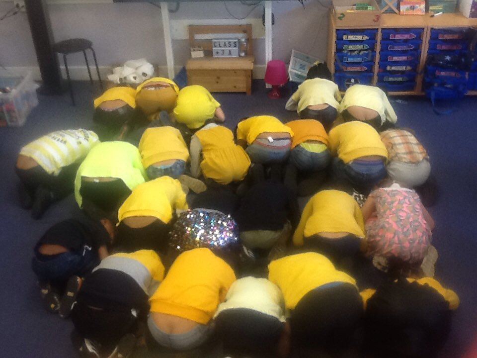3A showing our love and support for @YoungMindsUK by making ourselves into a yellow heart and doing some yoga to relax our minds