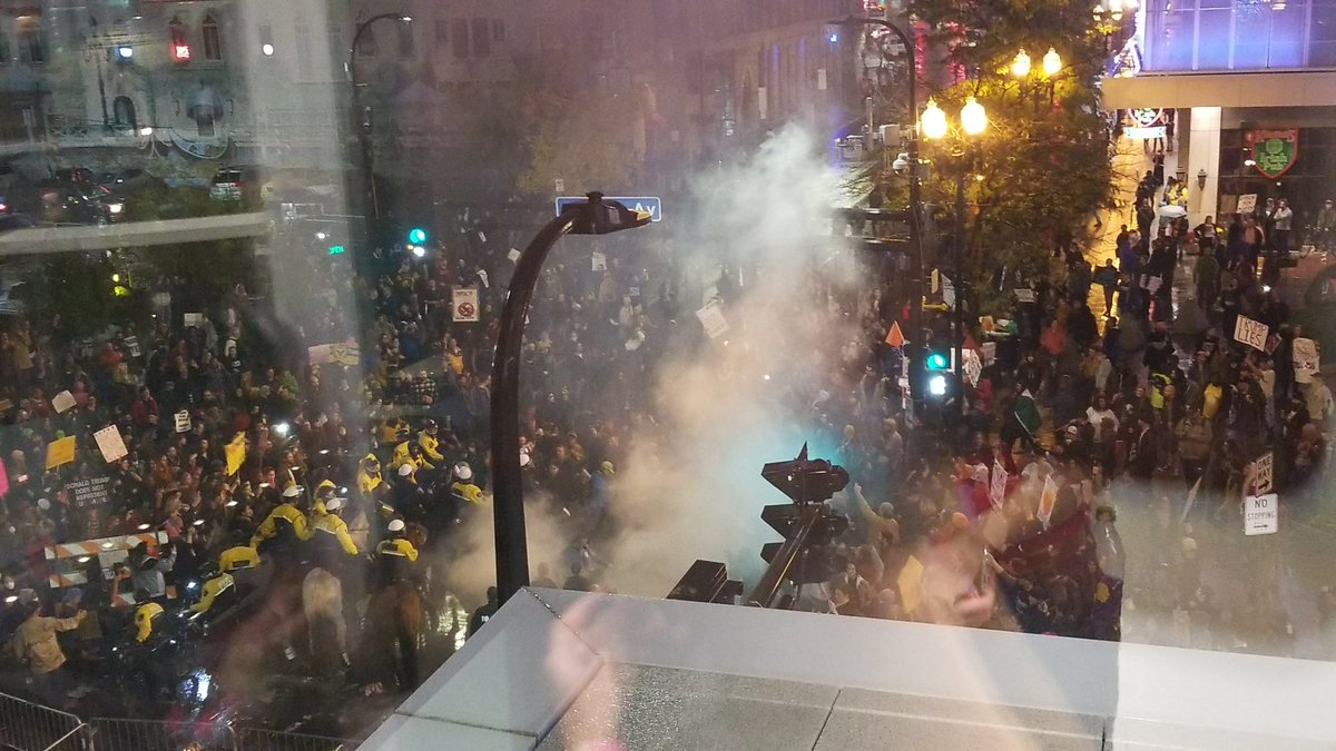 Protesters have started a fire on 1st Ave. Rally is about to let out.