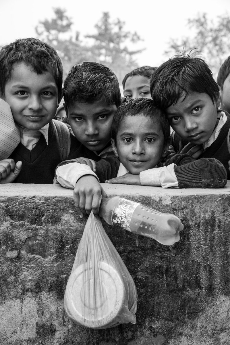 """Schools have long teaching hours. Classes run from morning till late afternoon. In between, there is a """"tiffin"""" break that students use to eat snacks & play different games. The empty Sprite bottle serves as a reusable water bottle for students. #Nepal #Madhes @digitalsubway"""