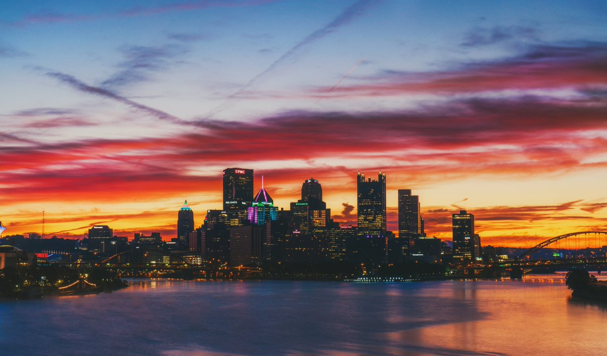 What a start to the day in #Pittsburgh this morning. Brilliant colors lit up the clouds over the city from the West End Bridge, as the lights of the city were shining bright below. There was even some mist on the river just before sunrise; really made for a beautiful scene. <br>http://pic.twitter.com/rttm3aNGRI
