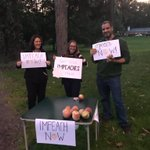 Image for the Tweet beginning: Activists handed out im-peachs outside