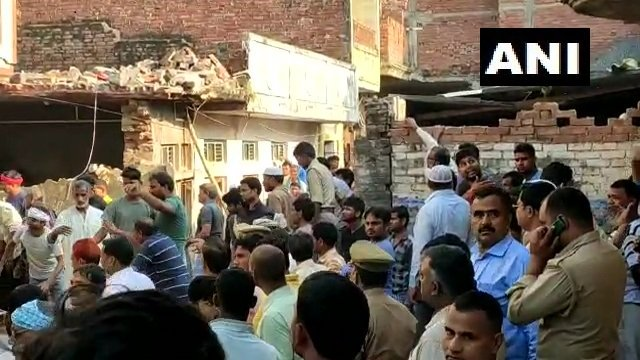 7 people killed, 15 injured after a two-storey building collapsed due to a cylinder blast in UP's Mau. Several feared trapped: News agency ANI.