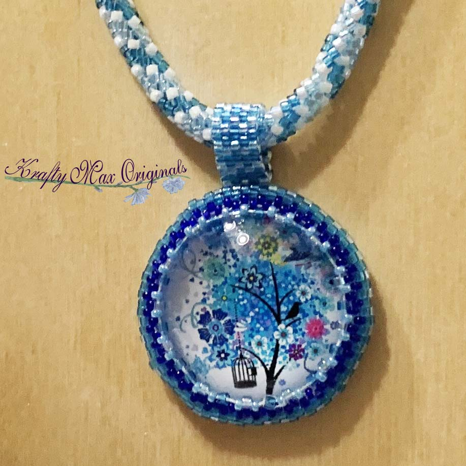 Blue Flower Tree with Bird Cage Beadwoven Art Necklace $110  #beadwoven #wearableart #art #offloom #original #handmade #buyhandmade #handmadelove #handcrafted #kraftymax #kmax #peyote #herringbone #bezel #necklace