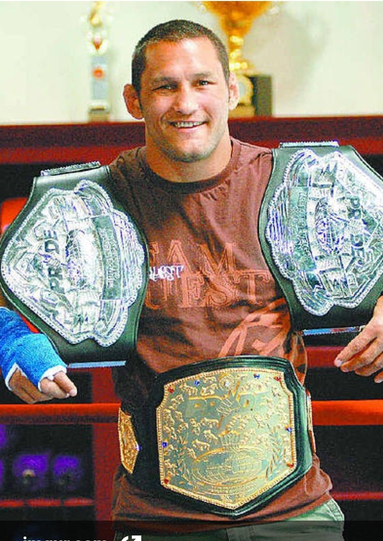 That's the welterweight grand prix belt but here's one with the middleweight belt and the welterweight belt as well as the beautiful grand prix belt. Legend.