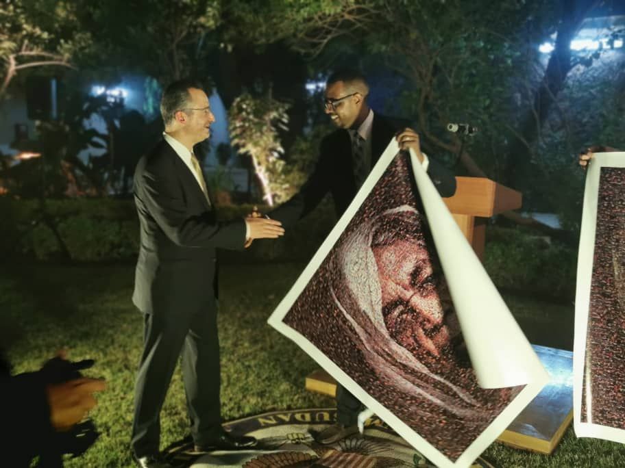 My brother @0smanSalih presenting the new US Chargé d'Affaires for Sudan, @USCDASudan Mr. Brian Shukan our Mosaics at the Embassy reception in Khartoum. @USEmbassyKRT #SudanUprising #sudanrevolutionart #IamTheSudanRevolution #Sudan<br>http://pic.twitter.com/OLU3PU1Wll