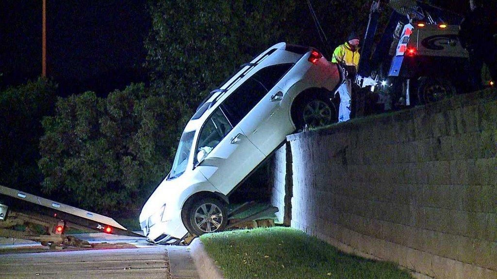 SUV hangs over ledge after man drives off retaining wall ketv.com/article/suv-ha…