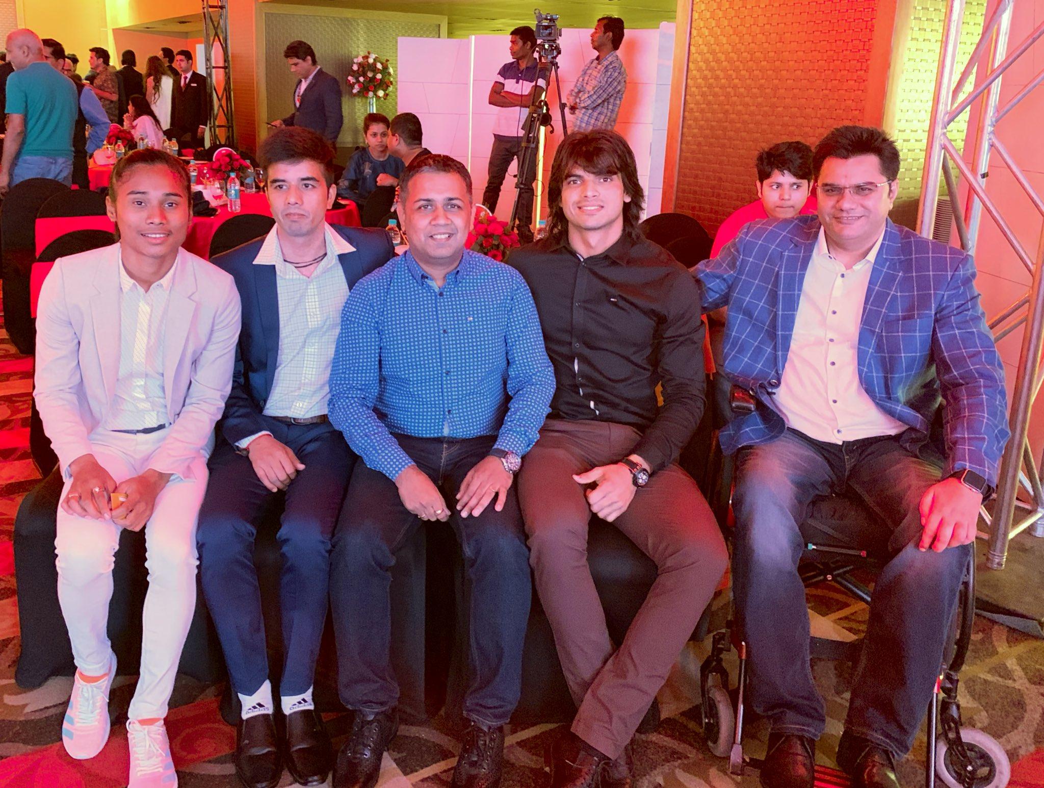 ImageRahul Trehan with Hima Das, Neeraj Chopra, Amit Saroha and Manish Singh Rawat