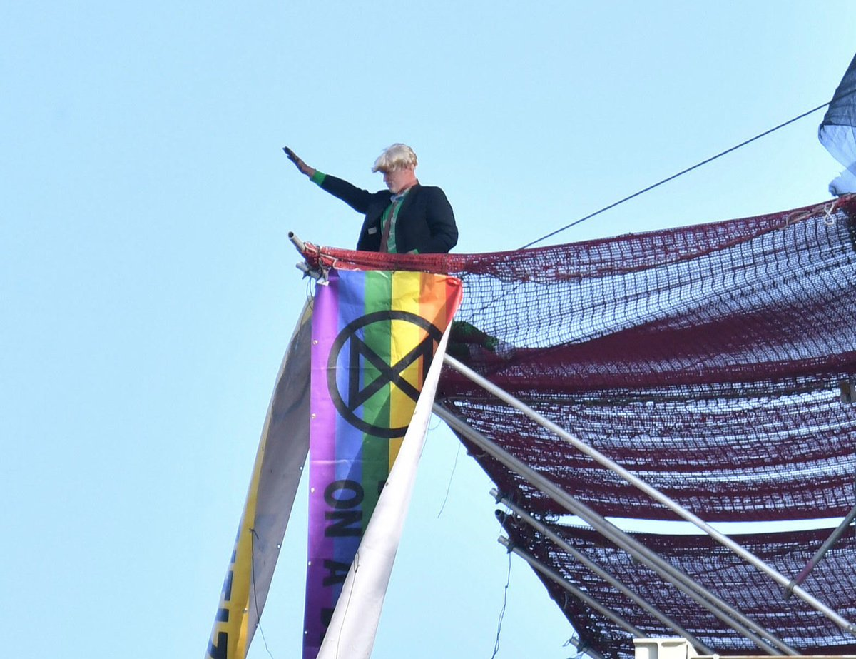 The protester, who has now unveiled a rainbow @ExtinctionR flag has been pictured near the top of Big Ben's scaffolding <br>http://pic.twitter.com/CuVUJNi9oY