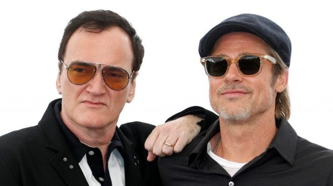 I don't deny Quentin Tarantino's talent. I also don't deny that he always looks in need of a swift cock-punch.