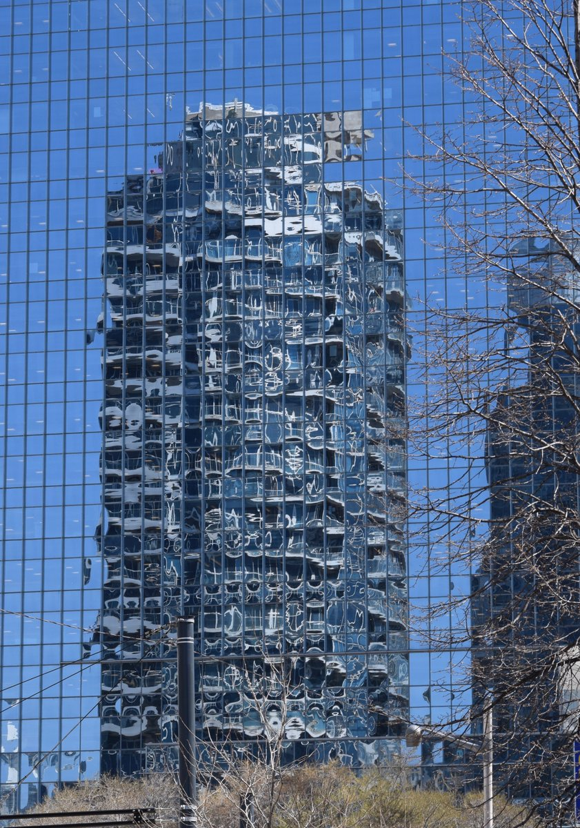 Our next entry in our #photoofthemonth is from Madeline Harbey entitled 'Toronto Building Reflection'. A great example of abstract imagery. #reflections #toronto #cityscape