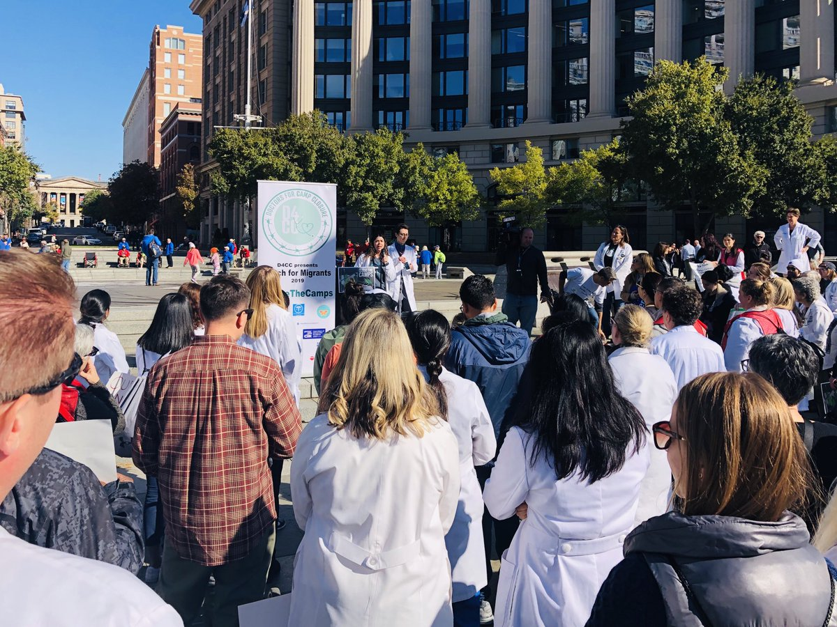 Doctors for Camp Closure are gathered in white coats right now at the Navy Memorial.They're about to start a 'March for Migrants' to the White House calling for the closure of border detention camps. @wusa9  #getupdc  #D4CC