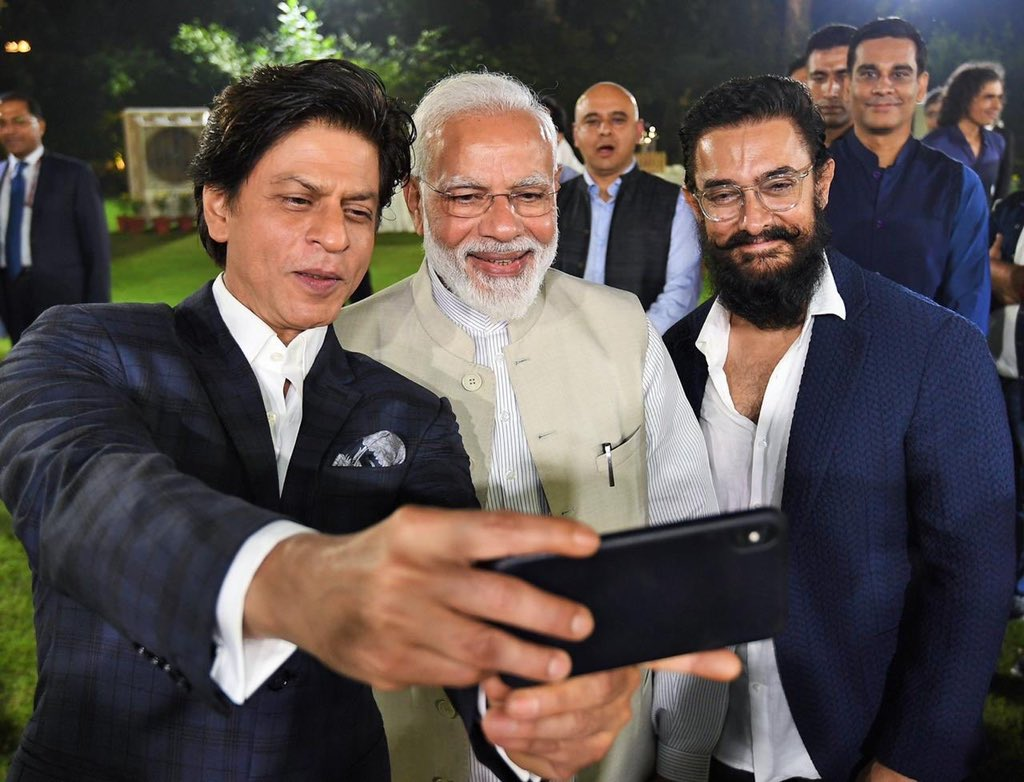 Two victims of NRC clicking picture with a True Indian in order to prove their citizenship to Amit Shah. (2019)<br>http://pic.twitter.com/NqHIG64Obd