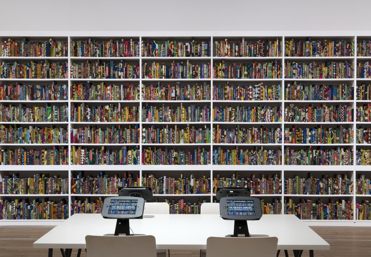 Artwork by Yinka Shonibare CBE: a colourful wall of thousands of books.