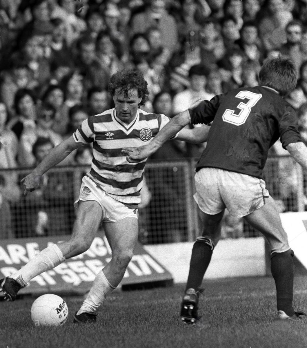 Davie Provan on the wing. the Hearts defender looks like a guy called George Cowie.
