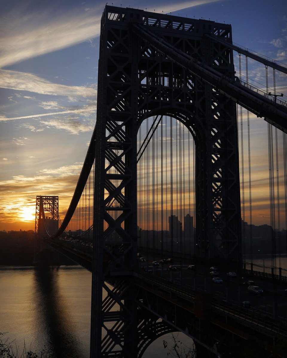 Sunrise behind the George Washington Bridge crossing the Hudson River from New York City to New Jersey #newyorkcity #nyc #newyork #sunrise #GeorgeWashingtonBridge @agreatbigcity