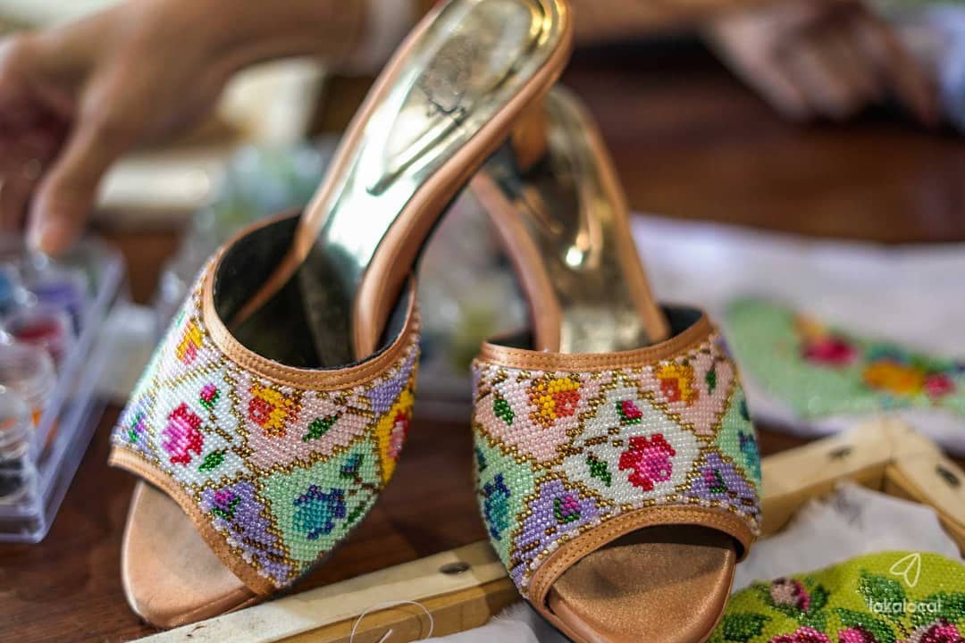Kasut manek are slippers with beaded toe coverings, worn by Peranakan Chinese women, together with a batik sarong and a kebaya.