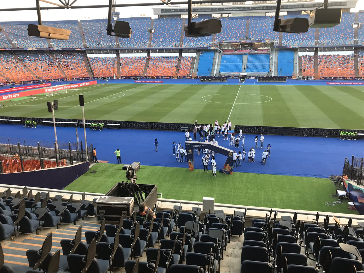 The Cairo International Stadium (L) is where the #AFCON2019 final was played. The pitch is superb. Compare that to the horrible Asaba pitch (R) where the @NGSuperEagles will play their #AFCON2021 QF against Benin Republic.<br>http://pic.twitter.com/ZikXqy4Jds