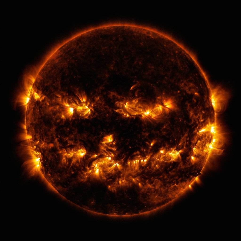 No, that's not a fiery jack-o'-lantern 🔥🎃. It's the Sun! Our @NASASun Solar Dynamics Observatory captured this ultraviolet image in 2014, showing active regions on our home star. #Halloween19 Download in hi-res: go.nasa.gov/2Wk5dWc