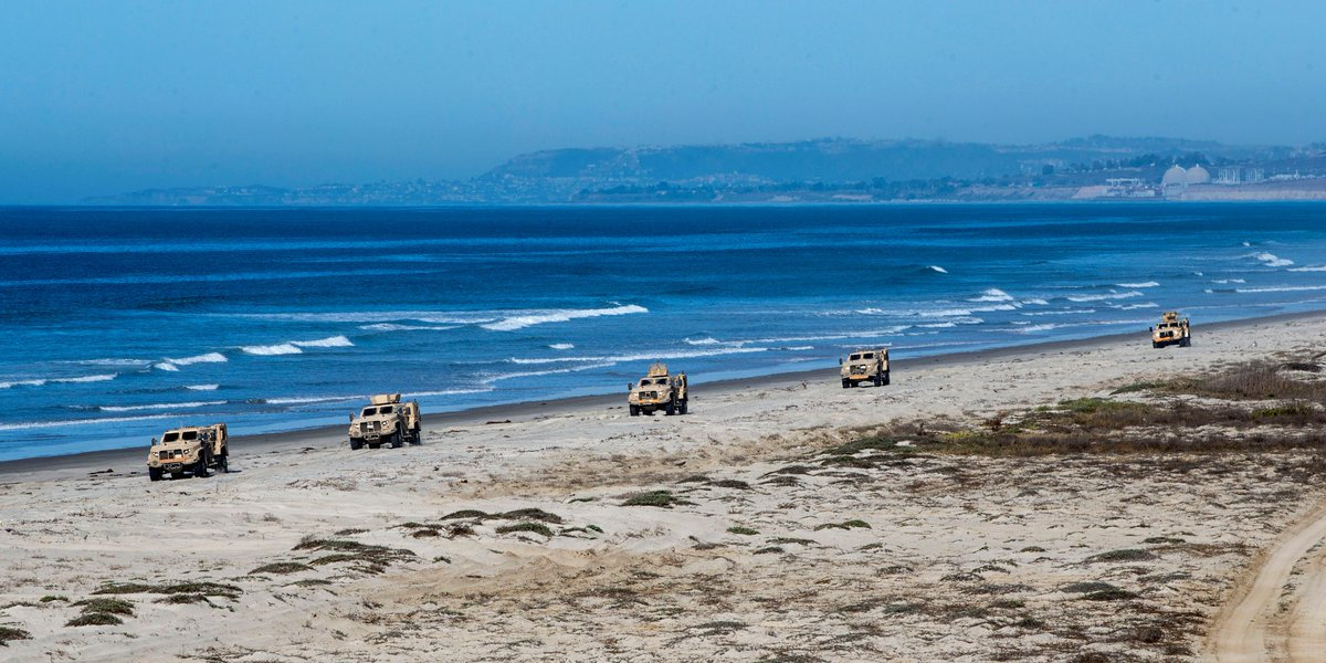 Line Up Marines drive Joint Light Tactical Vehicles at White Beach as part of the @1stMEF JLTV Operator New Equipment Training Course on @MCIWPendletonCA.