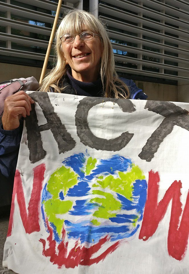 """""""Stand up and fight for what you love. I spent 40 years writing letters... But all I saw was more environmental degradation & emissions.... I've felt sad... But now I'm into strength & fight. #ExtinctionRebellion has given me hope"""", Delphine.   https:// rebellion.global /     #HumansOfXR <br>http://pic.twitter.com/pAYXOabYH6"""
