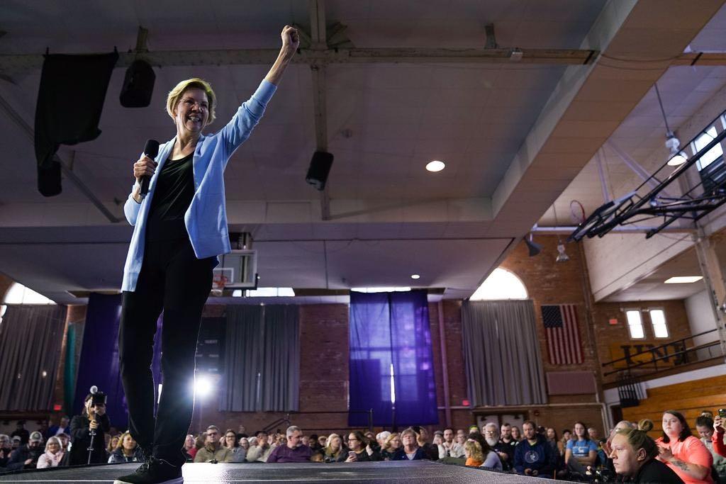 Elizabeth Warren waves to a crowd of supporters in Cedar Falls, Iowa.
