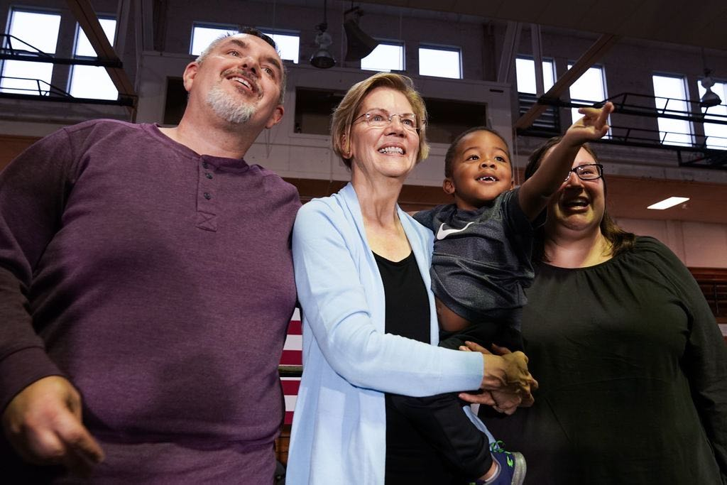Elizabeth Warren poses with a family after the Cedar Falls Town Hall.