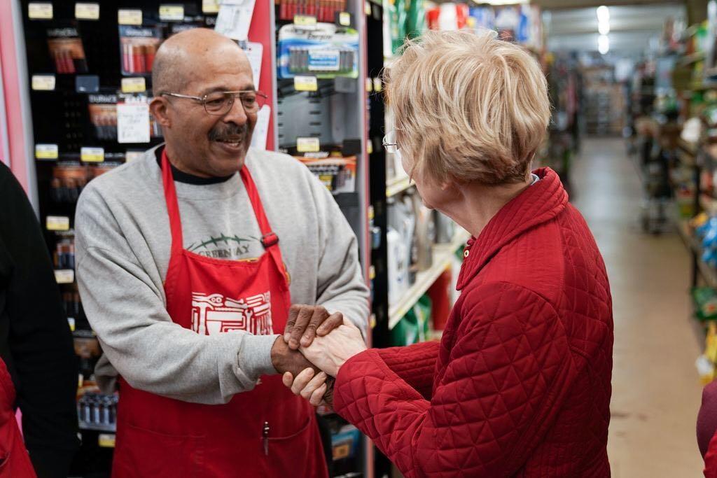 Elizabeth Warren shakes hands with an employee of a local hardware store in Waterloo, Iowa.