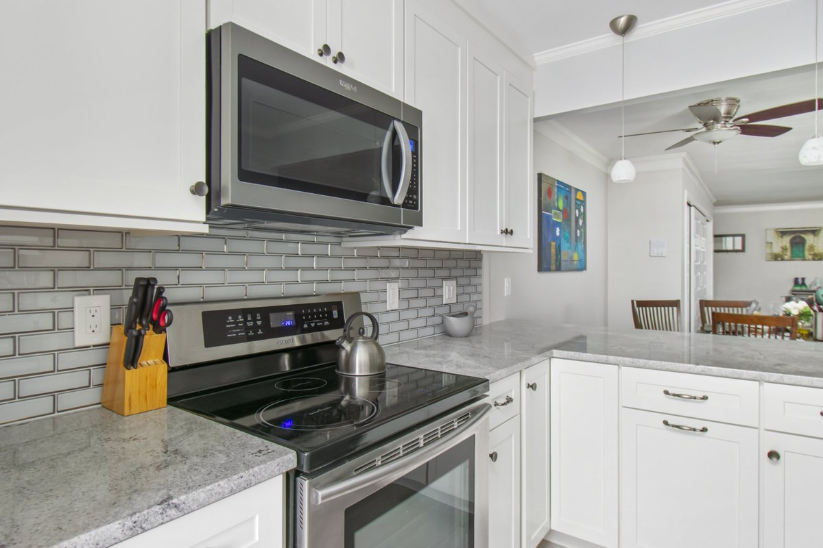 Kccne On Twitter Warwick Ri Kitchen Featuring Omni Door Style Cabinets In A Snow White Finish Himalayan White Countertops Ice Bevel Glass Subway Tile Backsplash Brushed Nickel Fixtures And A Wood Look Porcelain Tile