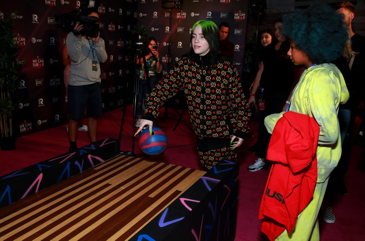 .@billieeilish bowls to #StrikeOutCancer backstage at Radio.com's #WeCanSurvive concert, Oct 19th at the Hollywood Bowl. The challenge: one ball, one strike & RADIO.COM makes a $10,000 donation in her honor to the @AmericanCancer. STRIKE it was!!