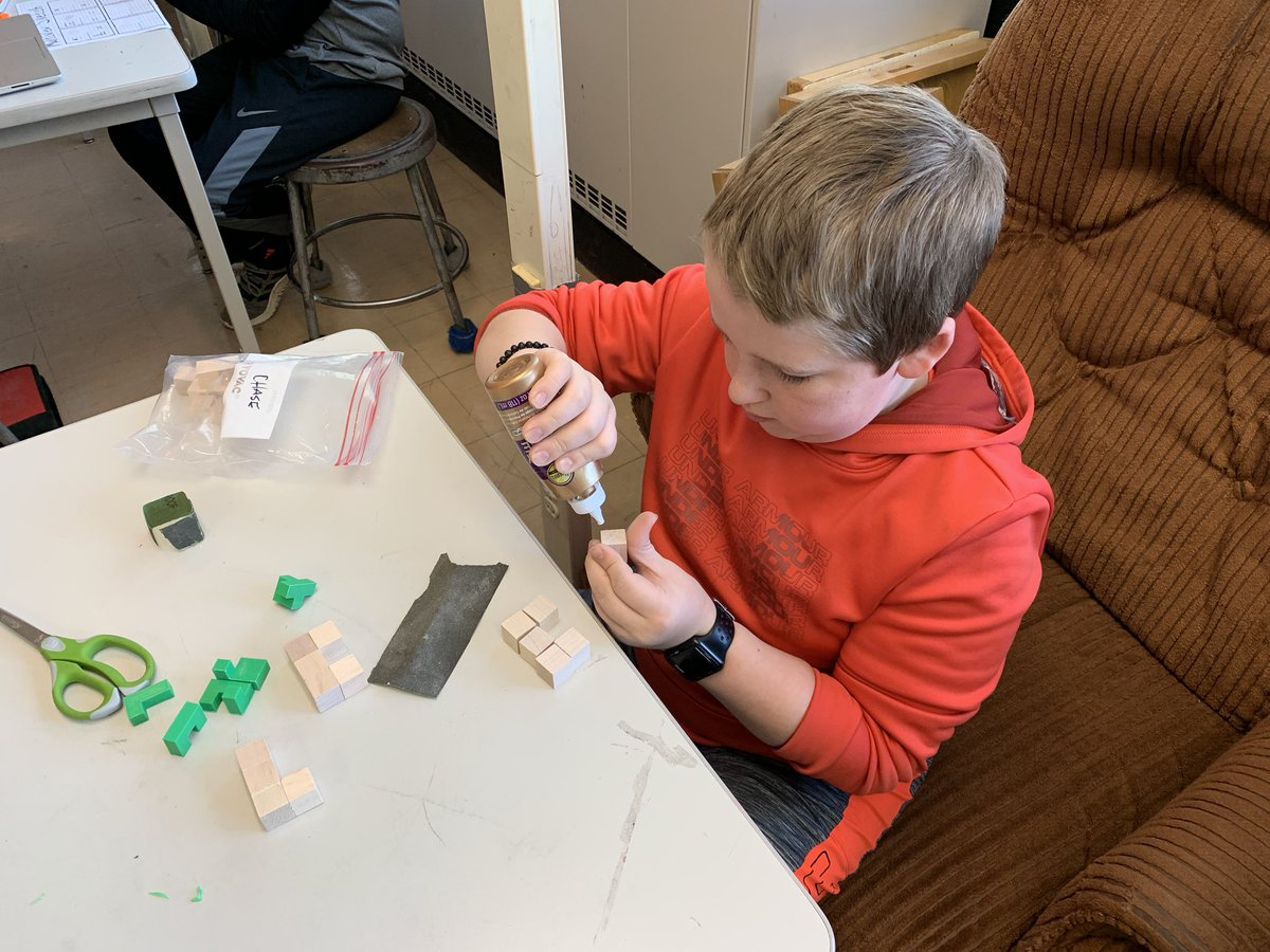 Sanding cubes, glueing carefully. Making our finished puzzle pieces. #pltw #glcsms #NationalSTEMDay <br>http://pic.twitter.com/CrVCL3gfLL