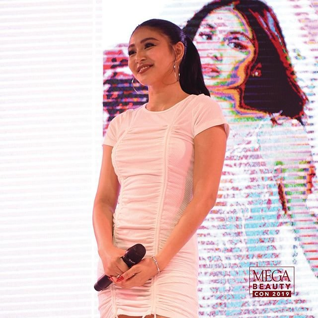 Radiant in white, Lustrous (@lustrousph) Creative Director and the next Making MEGA cover star #NadineLustre took to the stage to announce the winners of her exclusive meet and greet with #MEGABeautyCon2019 guests. <br>http://pic.twitter.com/C3K7NPJrko