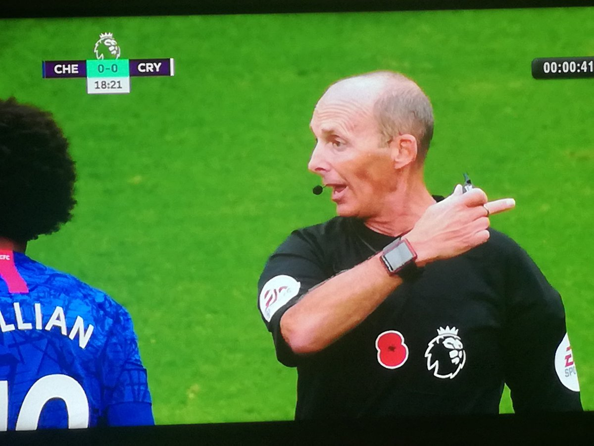 Mike Dean telling Wilfred Zaha to...  #CHECRY