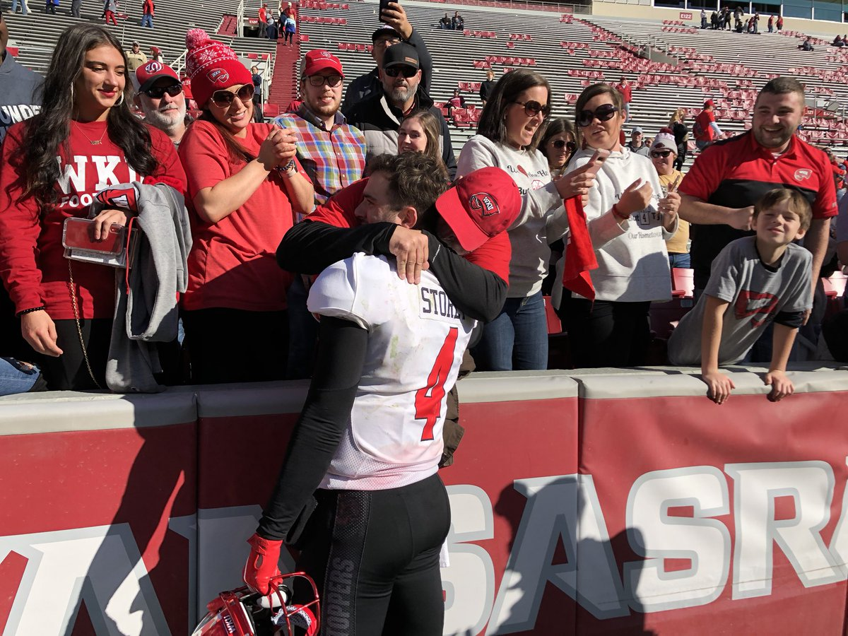 Ty Storey shares a special moment with his dad after WKU defeats Arkansas 45-19. The Hilltoppers become bowl eligible with today's win.