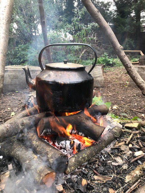 Making hot chocolate to warm ourselves up in Forest School!