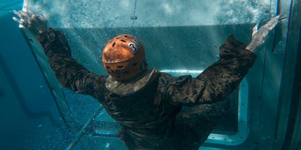 Submerged A Marine with 2nd Battalion, 5th Marine Regiment, @1st_Marine_Div, conducts Underwater Helicopter Egress Training at the Infantry Immersion Trainer Facility at Camp Horno on @MCIWPendletonCA.